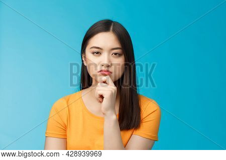 Close-up Serious-looking Female Asian Look Disbelief, Pondering, Solving Riddle, Squinting Hesitant
