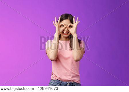 Cheerful Friendly Carefree Asian Woman Having Fun Fool Around, Show Okay Ok Signs On Eyes Make Glass
