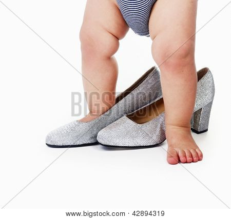 Little small baby in big shoe