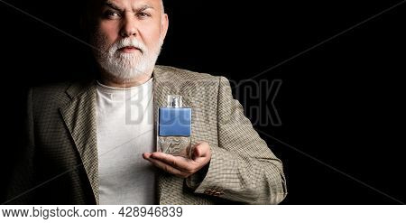 Masculine Perfume, Bearded Old Man In Suit. Male Holding Up Bottle Of Perfume. Aged Man Perfume, Fra
