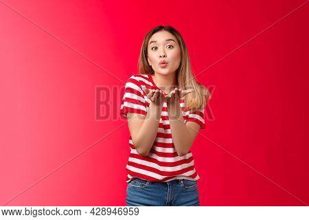 Silly Glamour Tender Asian Blond Modern Girl Send You Sweet Kisses. Joyful Urban Woman Wear Striped