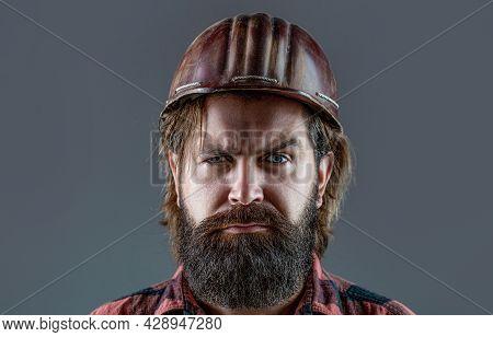 Builder In Hard Hat, Foreman Or Repairman In The Helmet. Building, Industry - Builder Concept. Beard