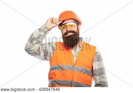 Bearded Man Worker With Beard In Building Helmet Or Hard Hat. Man Builders, Industry. Building Glass