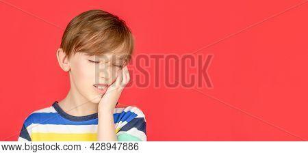 Toothache Painkiller. Dental Disease. Toothache As Dental Pain. Dentist Concept. Portrait Boy Has A