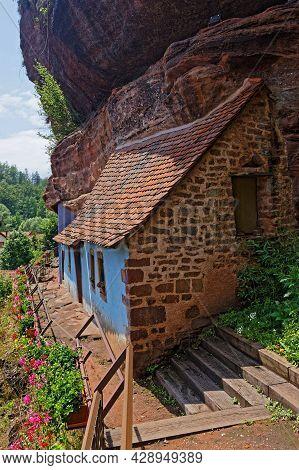 Eschbourg, France, June 25, 2021 : Semi-troglodyte Graufthal Rock Houses (maisons Des Rochers. House