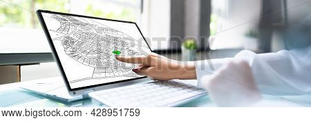 Cadastre Cartographic Map On Digital Laptop Screen In Office