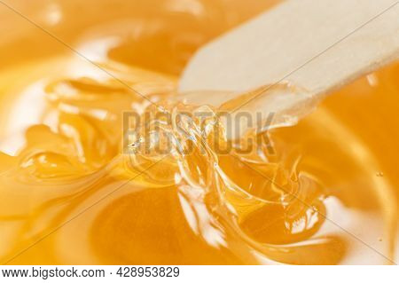 Sugar Paste Or Wax Honey In A Transparent Jar On A White Background. Sugaring. Depilation And Beauty
