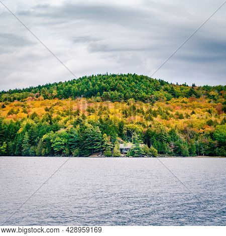 Fall colors on the shores of Long Pond in Acadia National Park in Maine