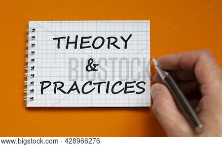 Theory And Practice Symbol. Businessman Writing Words 'theory And Practice' On White Note. Beautiful