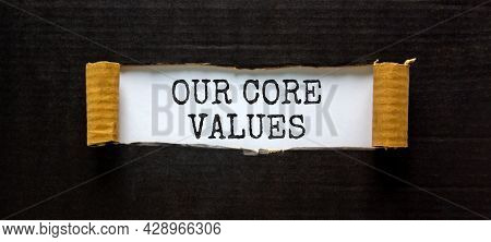 Our Core Values Symbol. Words 'our Core Values' Appearing Behind Torn Black Paper. Beautiful Black B