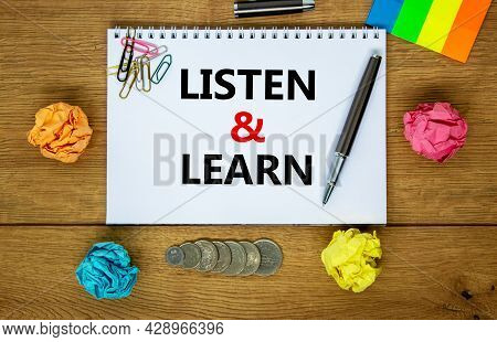 Listen And Learn Symbol. Words 'listen And Learn' On White Note. Ywooden Table, Colored Paper, Paper