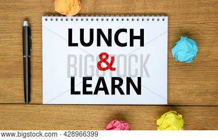 Lunch And Learn Symbol. Words 'lunch And Learn' On White Note On Beautiful Wooden Table, Colored Pap