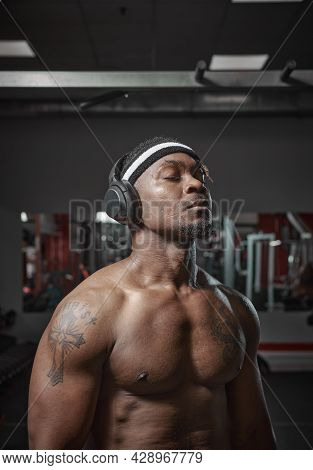 Athletic Muscular African American Man In Wireless Headphones Listening Music With Closed Eyes Durin