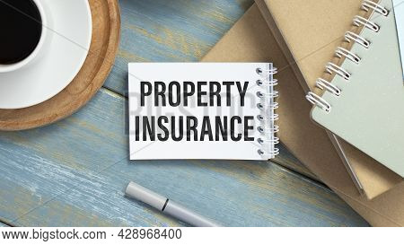 Property Insurance Protection Concept. Property Insurance Text Is Written On A Blank Sheet Of Paper