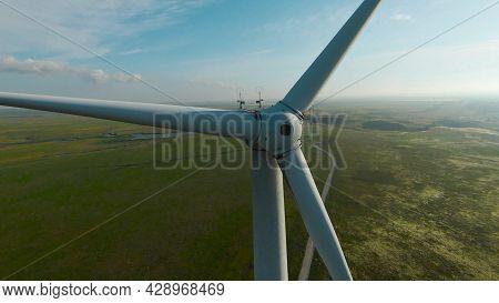 Top View Of Wind Generators. Shot. Drone Flies By Wings Of Wind Generator. Beautiful Flight With Win