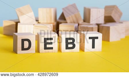 Debt Word Construction With Letter Blocks And A Shallow Depth Of Field