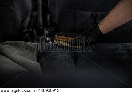 Man Car Detailing Studio Worker Cleaning Textile Car Upholstery