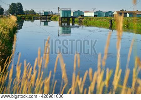 Agriculture Irrigation Pond. An Irrigation Pond And Pump House Used For Irrigation During The Growin