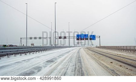 Driving in a snowstorm on the highway A1 near Amsterdam in the Netherlands in winter