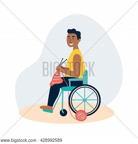 An African Man Knits In A Wheelchair. The Concept Of Employment For People With Special Needs, Hobby