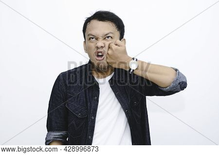 Funny Face Of Angry Asian Man Punish Himself By Hit On His Own Face.