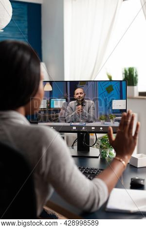 African American Woman Greeting Remote Entrepreneur Using Laptop Computer Webcam During Online Video