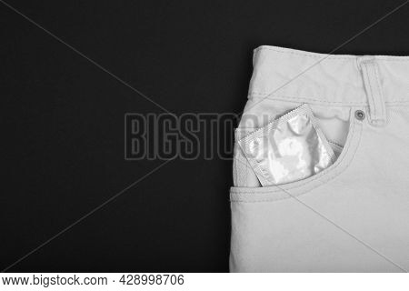 Condom In Package In White Jeans. Men Found Condoms To Prevent Sexually Transmitted Infections Or Ai