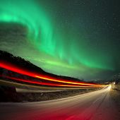 Northern Lights and car light trails Northern Norway. poster