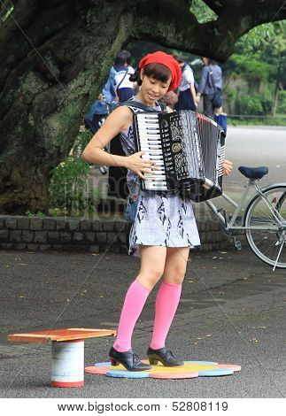 Street Musician Playing The Acordeon In Ueno Park, Tokyo.