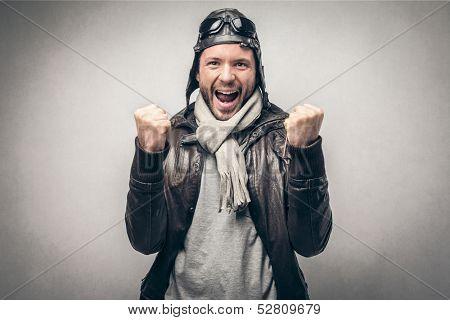 portrait of a happy aviator exults