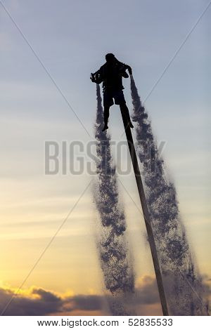 Cancun, Mexico - Oct 16, 2013:  A unidentified man using a water powered jetpack in Cancun, Mexico on Oct 16, 2013.
