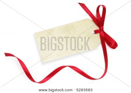 Blank grunge gift tag tied with a bow of red satin ribbon. Isolated on white with soft shadow. poster