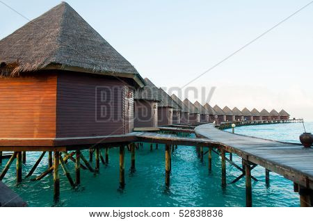 the overwater bungalows in Maldives paradise island poster
