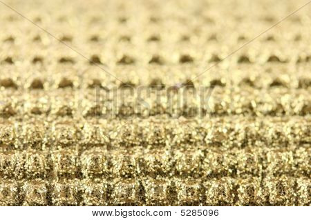 Abstract background - a closeup photo of golden glitter. poster
