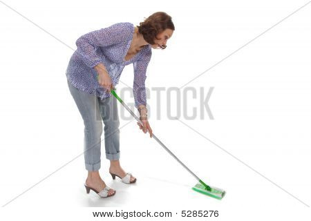 Woman Washes Up The Floor By A Swab