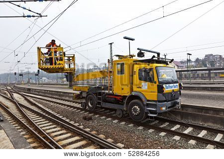 Worker Repair The Catenary In The Station