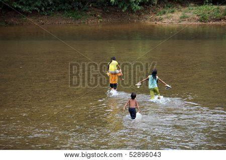 Children Cross A Stream