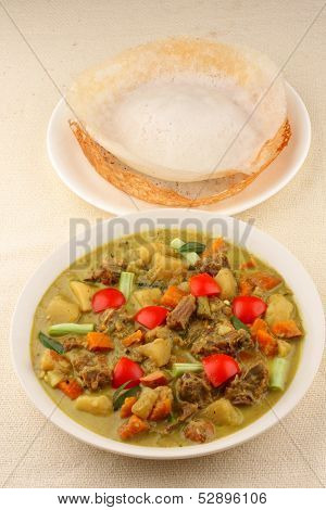 Appam with mutton stew