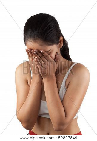 shy indian girl hiding face laughing