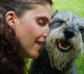 Female pet ownder showing affection for her miniature schnauzer dog poster