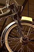 Close up of old bicycle with spin rag on the wheels poster