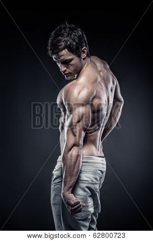 Strong Athletic Man Fitness Model Posing Back Muscles And Triceps