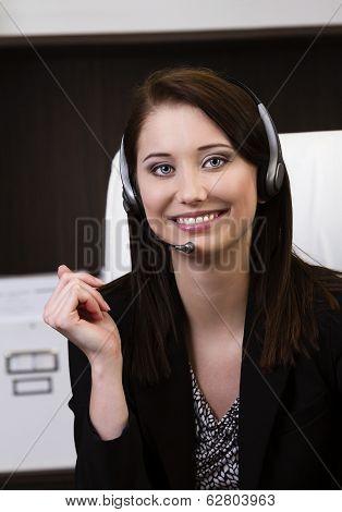 Closeup Of A Female Call Center Employee Smiling