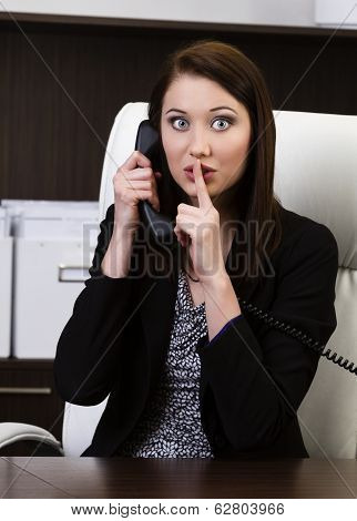 Successful Businesswoman Gesturing Keep Silence