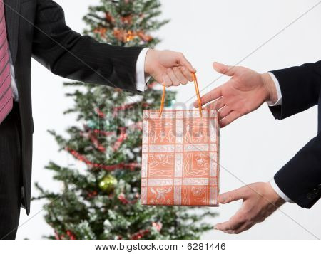 business man giving a christmas present