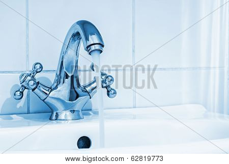 Water Tap With A Water Stream In The Bathroom
