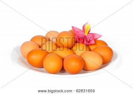 Easter Eggs On The Plate With Pink Paper Flower