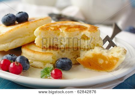 Homemade delicious pancakes with fresh berries and honey poster