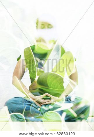 Double exposure photograph of meditating woman combined with photograph of nature