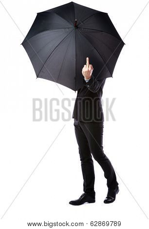 Business man hidden in umbrella and shows fuck off against white background